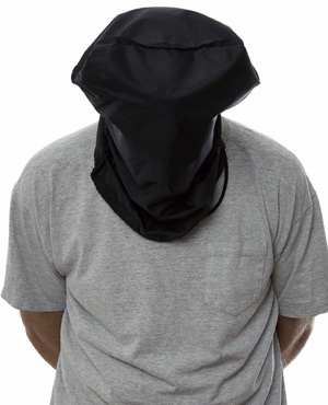 Man with a black hood over his head and his hands tied behind his back.